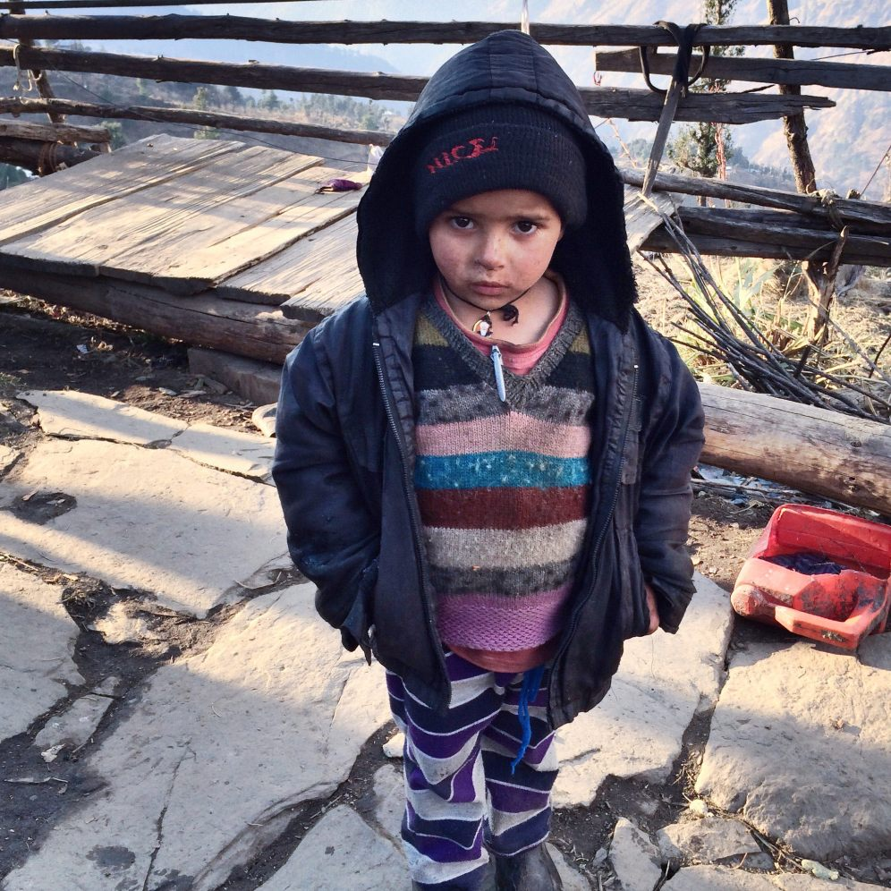 Red cheeked child I met on my way down to Sankri